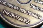 """An AA medallion emblazoned with the Serenity Prayer: """"God grant me the serenity to accept the things I cannot change, the courage to change the things I can, and the wisdom to know the difference."""""""