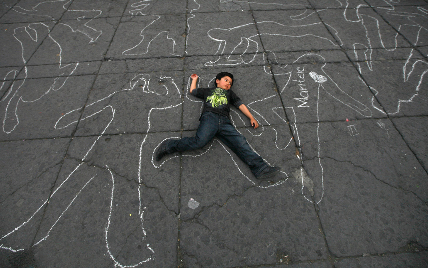Shot of the Day: Children Lie Down In Protest Against the Mexican Drug War