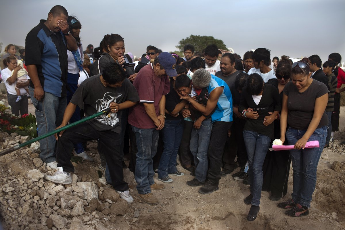 An entire community mourns the deaths of two sisters murdered during a birthday party. Photo Via