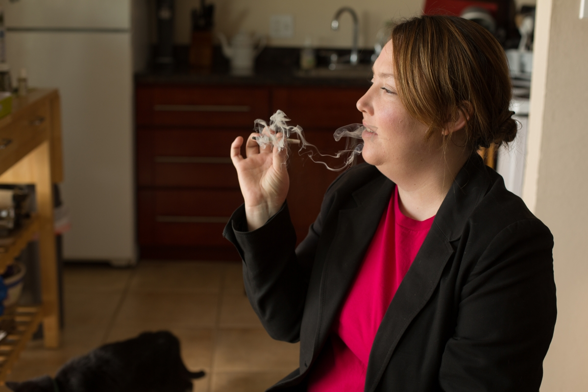 """Younger white female smoking a cannabis cigarette in her home""  Sonya Yruel/Drug Policy Alliance"