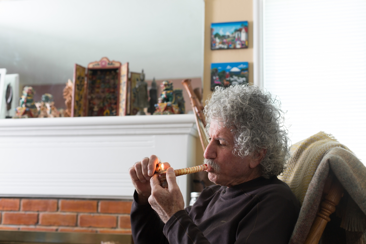 """Older white male smokes cannabis through a water pipe in his home""  Sonya Yruel/Drug Policy Alliance"