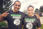"Bobby Bird, Jr. and Amanda Mandoka, who are both in recovery, model ""Siouxper Sober"" T-shirts. Photo via"