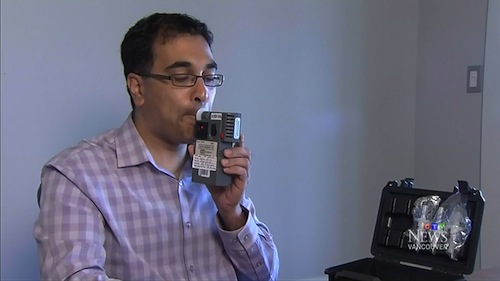 Dr. Attariwala tries out his week breathalyzer Photo via