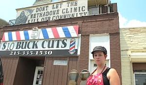 The owner of $10 Buck Cuts protests the planned methadone clinic next door.