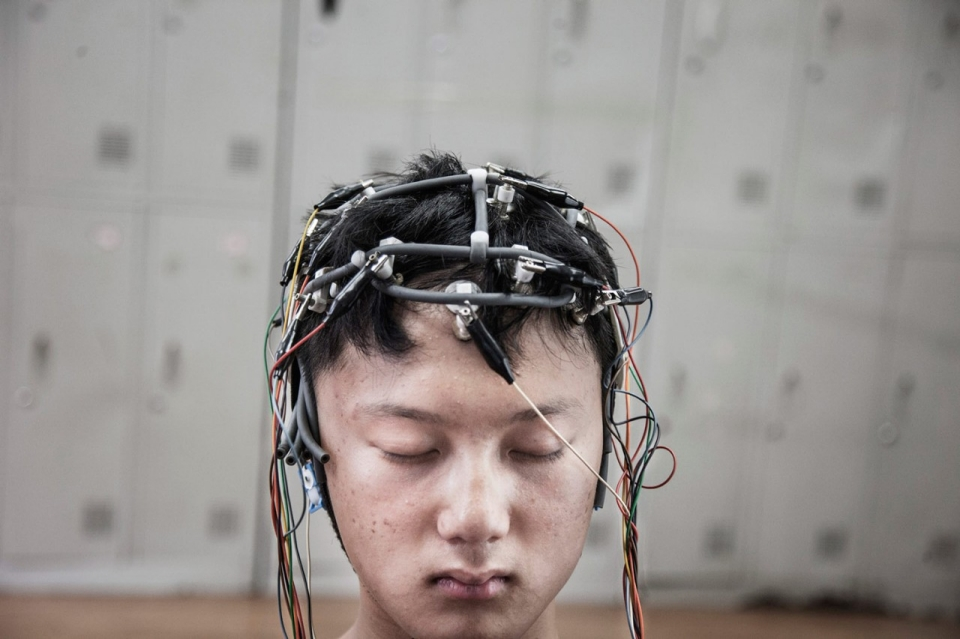 13-year-old Lu Jung Song is checked with to measure his cerebral bioelectrical activity.