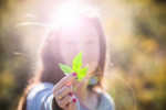 substance-shutter218988490-girl-holding-marijuana-leaf