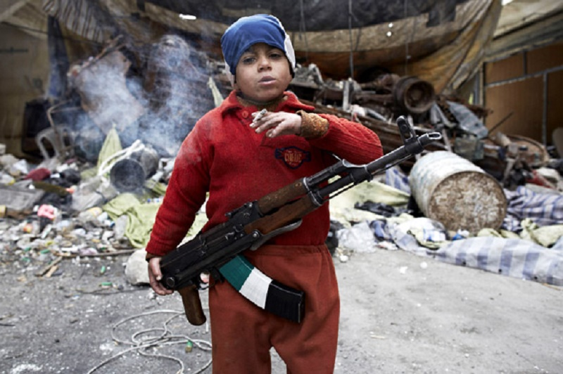 Shot of the Day: A Seven-Year-Old Syrian Soldier Smokes Like a Pro